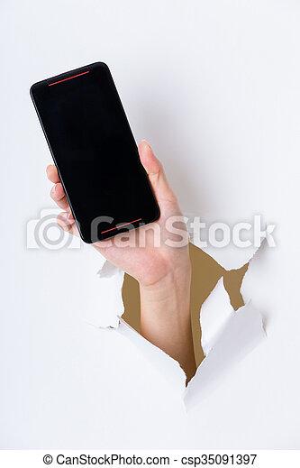 携帯電話, 穴, ペーパー, によって, 手 - csp35091397